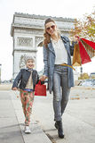 Happy mother and daughter near Arc de Triomphe going forward Stock Image