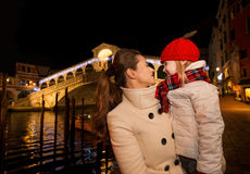 Happy mother and daughter near Rialto Bridge in Christmas Venice Stock Photography