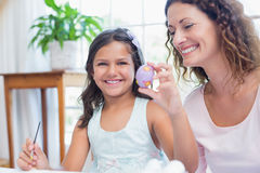 Happy mother and daughter painting easter eggs Royalty Free Stock Photos
