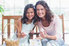 Happy mother and daughter painting easter eggs Royalty Free Stock Photography