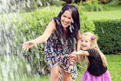 Happy mother and daughter in park Stock Images