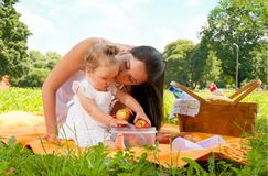 Happy mother with daughter in the park picnicking Stock Photo