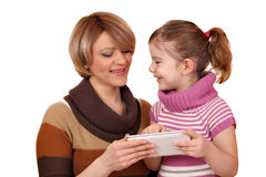 Happy mother and daughter play with tablet pc Royalty Free Stock Image