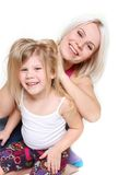 Happy mother and daughter playing Stock Photos