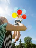 Happy Mother And Daughter Playing With Balloons Stock Photography