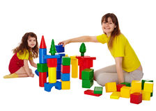 Happy mother and daughter playing with blocks Royalty Free Stock Photography