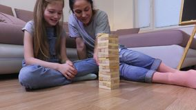 Happy mother and daughter playing board game stock video footage