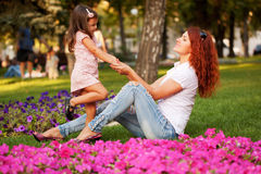Happy mother and daughter playing Stock Images