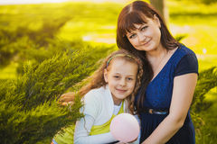 Happy mother and daughter are playing in the park Royalty Free Stock Photo