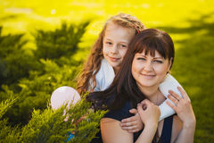 Happy mother and daughter are playing in the park Royalty Free Stock Image