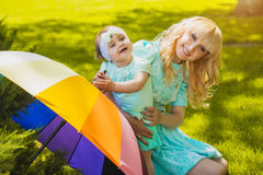 Happy mother and daughter are playing in the park Royalty Free Stock Photos