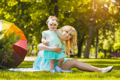 Happy mother and daughter are playing in the park Stock Photography
