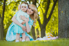 Happy mother and daughter are playing in the park Stock Images