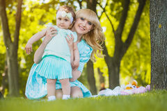 Happy mother and daughter are playing in the park Stock Image