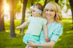 Happy mother and daughter are playing in the park Royalty Free Stock Photography