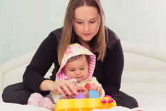 Happy mother and daughter are playing together Royalty Free Stock Image