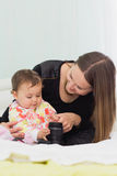 Happy mother and daughter are playing together Royalty Free Stock Photography