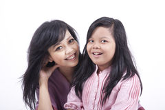 Happy mother and daughter portrait. Happy Asian mother and daughter isolated on white Stock Image