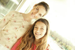 Happy mother and daughter portrait. Happy mother and daughter smiling outdoors Stock Image