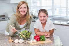 Happy mother and daughter preparing salad together Royalty Free Stock Photography