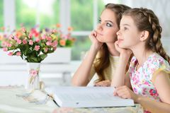 Mother and daughter reading Stock Image