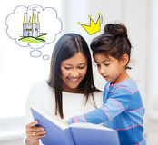 Happy mother and daughter reading fairytale book Royalty Free Stock Photography