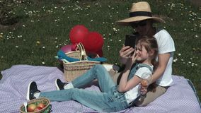 Happy mother and daughter relaxing on picnic stock video footage