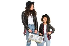 Happy mother and daughter with retro boombox. Isolated on white royalty free stock image
