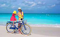 Happy mother and daughter riding bicycles on Royalty Free Stock Images