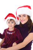 Happy mother and daughter in santa hat Royalty Free Stock Images