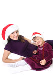 Happy mother and daughter in santa hat Royalty Free Stock Photos