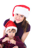 Happy mother and daughter in santa hat Stock Photography