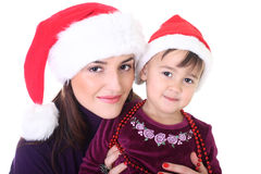 Happy mother and daughter in santa hat Royalty Free Stock Photo