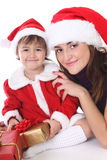 Happy mother and daughter in santa hat Stock Images