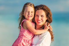 Happy mother and daughter at sea coast Stock Photography