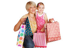 Happy mother and daughter with shopping bags Stock Photo