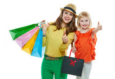 Happy mother and daughter with shopping bags showing thumbs up Stock Photography