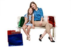 Happy a mother and daughter with shopping bags Stock Photos