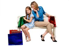 Happy  mother and daughter with shopping bags Royalty Free Stock Image