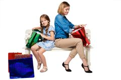 Happy  mother and daughter with shopping bags Stock Images