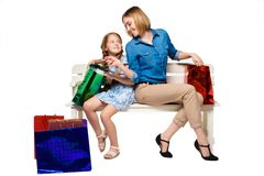 Happy  mother and daughter with shopping bags Stock Photography