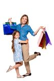 Happy a mother and daughter with shopping bags Royalty Free Stock Photos