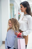 Happy mother and daughter in shopping mall Stock Image