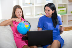 Happy mother and daughter shopping online, Stock Images