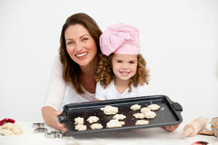 Happy mother and daughter showing a plate Stock Photography