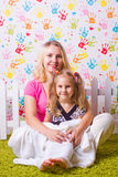 Happy mother and daughter sit Royalty Free Stock Image