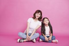 Happy mother and daughter sitting together royalty free stock photos