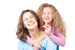 Happy mother and daughter smiling Stock Photos