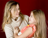 Happy mother and daughter smiling Royalty Free Stock Photos
