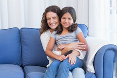 Happy mother and daughter smiling at camera Stock Photos